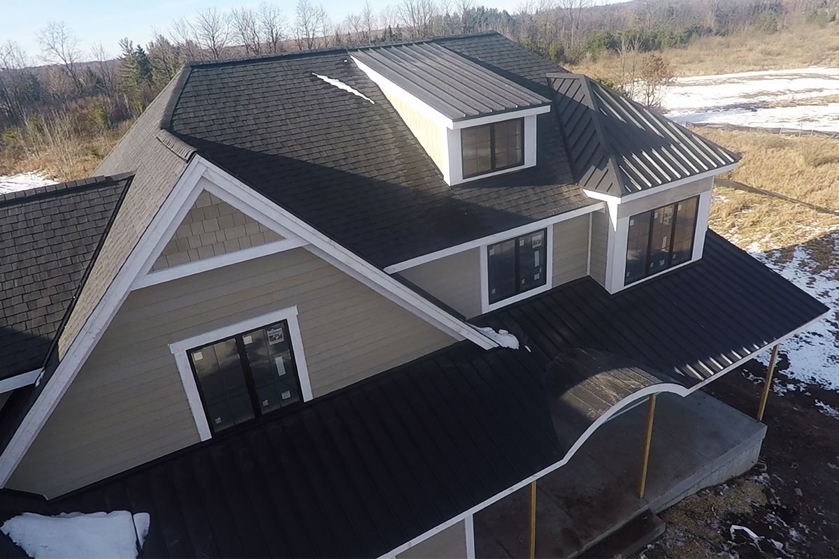 Black Standing Seam Amp Asphalt Roof Mequon Bci Exteriors